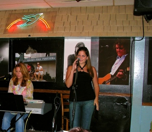 Hillary Scott, then 19, trying to get a start on the stage of the Bluebird, Nashville, TN.  She later, with two men, formed Grammy-Award winning group Lady Antebellum.  Taken 8/24/2005.